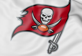 Close-up of waving flag with Tampa Bay Buccaneers NFL American football team logo, 3D rendering